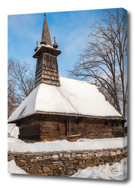 Traditional wooden church covered in snow