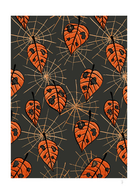 Orange Leaves With Holes And Spiderwebs