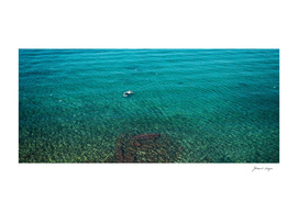 Man snorkling in turquoise sea