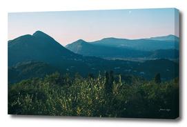 Mountain landscape in hazy sunlight