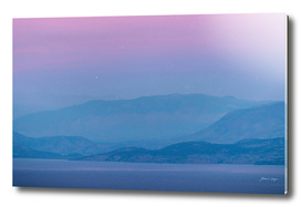 Sea and mountains at dusk