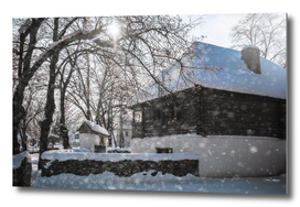 Beautiful winter day with snowfall in a Romanian Village