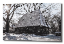 Snowing on a wonderful winter day on a Romanian Cottage