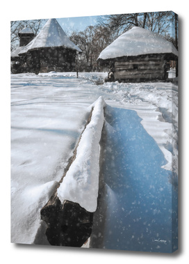 Heavy snow cover in a Romanian village in winter