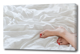 Feet on white linen