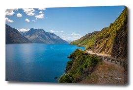 Scenic winding road at Lake Wakatipu, New Zealand