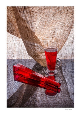Still life with a red bottle