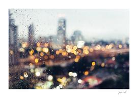 city lights in rain