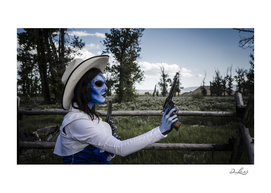 Gunslinging Blue Alien Cowgirl