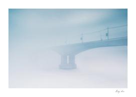 Bridge in winter fog on morning Russia