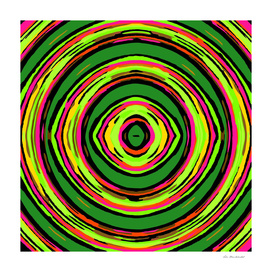 psychedelic graffiti circle pattern in green pink and yellow