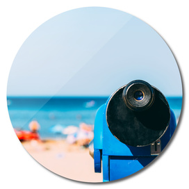 Blue Coin Operated Telescope With Beach And Ocean Background