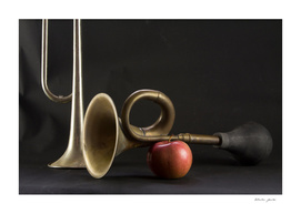 Two trumpets and an apple