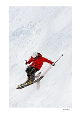 Daring Skier Flying Down a Steep Slope