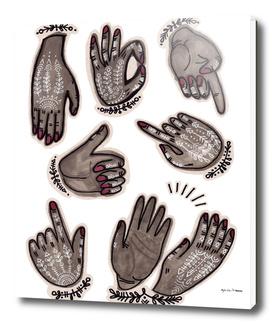 hand gestures and white henna tattoo