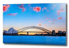 Sunset behind Opera House and Sydney Harbour Bridge