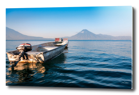 Small boat on the blue waters of Lake Atitlan