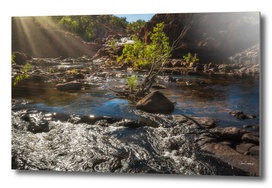 Sun rays at Edith Falls, Northern Territory, Australia.