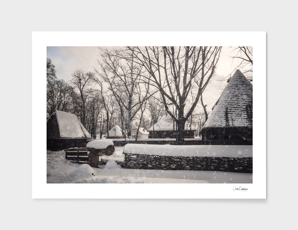 Snowing over a traditional homestead at Village Museum