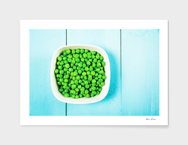 Fresh Green Peas In White Bowl On Turquoise Table main illustration