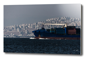 Boat full of containers on the sea in Izmir