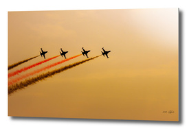 Acrobatic aviation squadron in the sunset