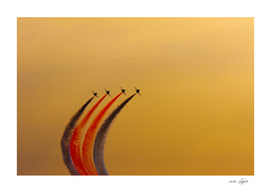 Acrobatic aviation squadron flying in the sunset
