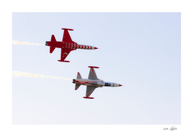 Turkish acrobatic aviation squadron performing.