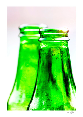 Two green bottles of fresh water