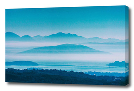 Misty bay with mountains