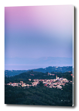Village in hills at sunset. Corfu, Greece.