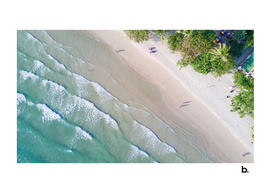 Fly over the Tropical Island Beach. Ocean waves.
