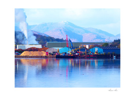 Industrial reflection at mountains edge
