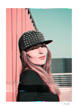 Portrait of a beautiful girl in a cap with studs