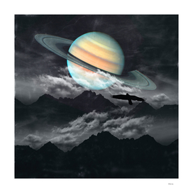 Saturn above Mountains