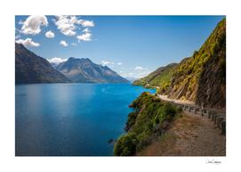 Scenic winding road at Lake Wakatipu, New Zealand