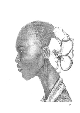 Black woman with white orchid