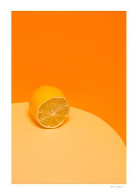 Cut fresh lemon on a yellow-orange background