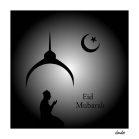 Man praying under the moon- Eid Mubarak