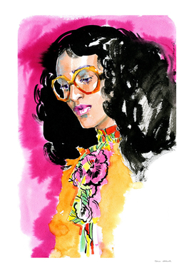 A woman in bright clothes and trendy glasses on pink