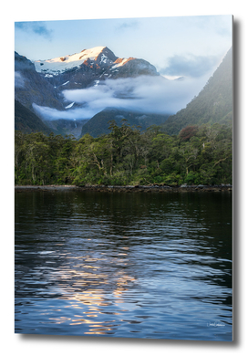 Sunset in beautiful Harrison Cove at Milford Sound
