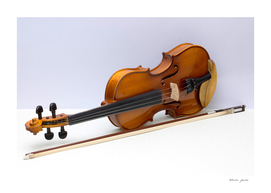 violin with bow over gray background