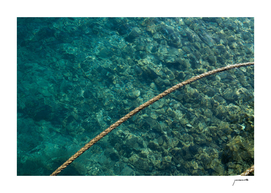 Rope over clear water