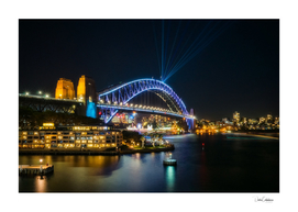 View of Sydney Harbour Bridge illuminated for Vivid