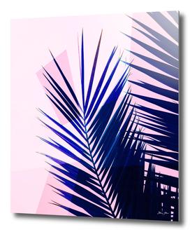 Indigo palm leaves on pastel pink geometry