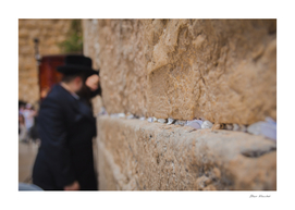 Religious orthodox jew praying at the Western Wall
