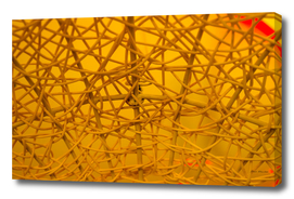 Texture of plastic rattan straw chair on yellow color