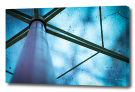Abstract image of a blue parasol with metal frames