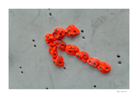 Red climbing holds in the shape of an red arrow