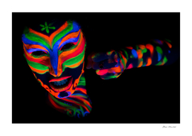 Woman with make up art of glowing UV fluorescent powd